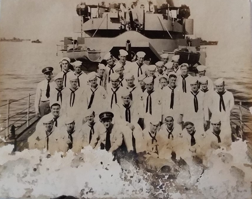 Dad and crew on deck of USS Strickland